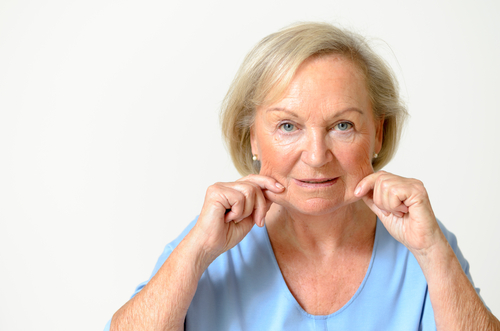 senior woman wearing blue shirt while showing her face, effect of aging caused by loss of elasticity-img-blog