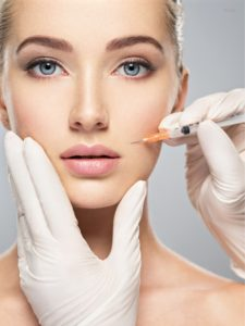 Woman getting BOTOX® Cosmetic injection in nasolabial fold