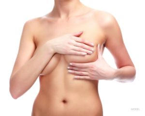 Woman on white background. Breast correction and plastic surgery concept